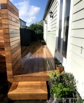 Vibrant Deck Transformation - A very excited home owner gets to enjoy an ice cold beverage on their beautiful new Vitex deck, & just in time for summer! ☀️