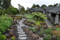 Stones in the landscape by Stone Creations - Bombay bluestone used for stepping stones and also used on the stonework on the house, with local basalt boulders in garden.