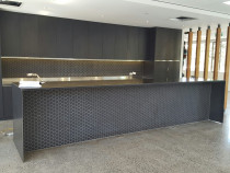 Splashback and Kitchen Bench Tiling - Black mosaic tiles on the kitchen splashback and in front of island bench.