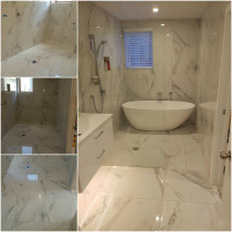 Bathroom Tiled with 600 x 600 marble look tile.