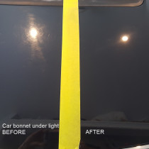 Black Car Bonnet - Before And After Cut n Polish by The Mobile Car Specialists Ltd - Bonnet under lighting with yellow tape dividing the sides: