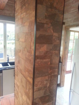 Kitchen pillar porcellain stone pattern black metal trimmed by The Tiler