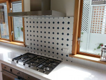 Black and white mosaic feature wall by The Tiler