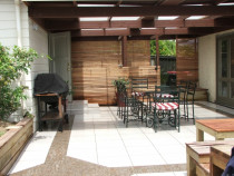 Outdoor Patio with Crazy Pave Sandstone Inset by Tile Technix Ltd - Tilers