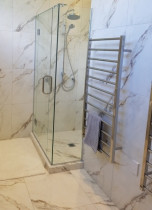Frameless glass shower - This lovely tile keeps the bathroom very light, we also used epoxy grouting which makes it easy to clean.