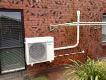 Wall Bracket - Vincent Install Ltd - This install utilized a Galvanized Cantilevered wall bracket secured directly to the house blockwork. It was installed to the left of the clothesline to allow the function of collapsing and raising the clothesline to be unimpeded.