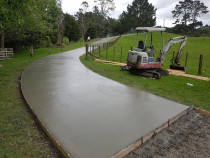 Virtuoso's concrete driveway in Dairy Flat - Virtuoso recently completed this 500m concrete driveway in Diary Flat. We specialize in hard landscaping and do many rural driveways.
