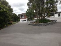 reconcreting driveway and building retaining wall garden