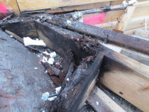 Waterproofing membrain  inspected by Weathertight Home Inspections - Damage to framing timber due to pipe bracket fixings